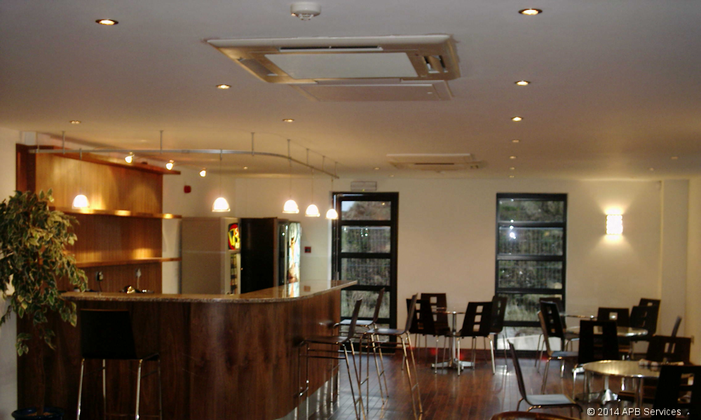 Example ceiling based air conditioning system installed into a cafe